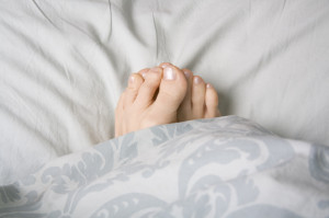 Feet in duvet