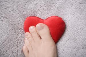 Foot on heart