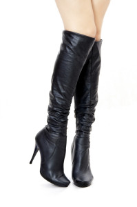 Sexual black female high boots on a high heel