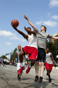 Man Shoots Against Defender In Outdoor Street Basketball Tournam