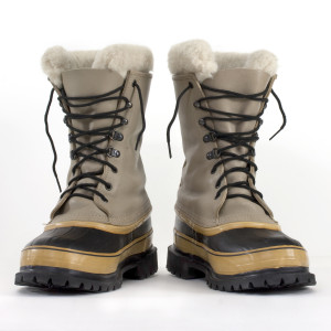 a pair of heavy snow boots on white background, low angle perspective